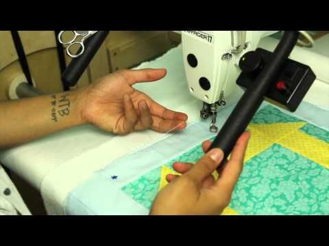 In this video I show you how I baste my quilt tops on my longarm frame. This video is Part 2 in a tutorial series of how to load your quilts on a longarm frame.  For part 1 on loading the quilt click here:http://youtu.be/28pS90e2-jI  I no longer use side clamps when loading or basting my quilts on the longar...