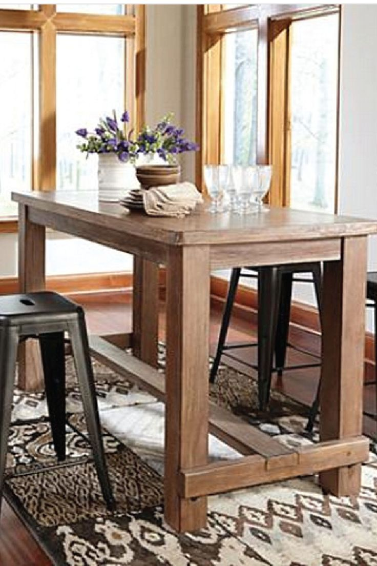 Bring this counter height dining room table into your home for a sophisticated and elegant piece of furniture. Pair it with your favorite stools for a mismatched and eclectic feel.