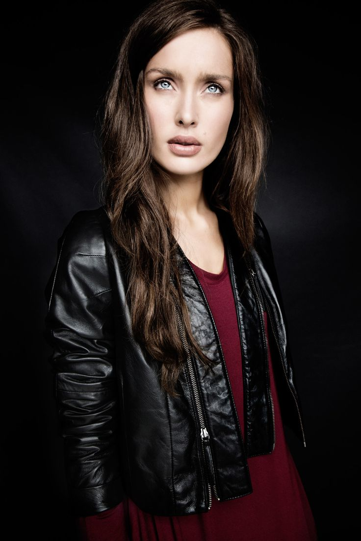 Fitted black leather jacket and asymmetric red dress, both Carolyn Donnelly The Edit