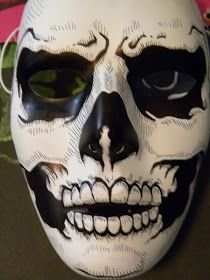 My son brought me some plain white theater masks to paint so you know one would have to be a skull
