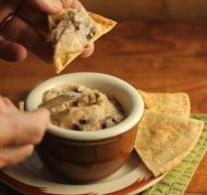 Use this Slow Cooker White Bean, Garlic and Olive Dip or Spread recipe as a dip for chips at your next party