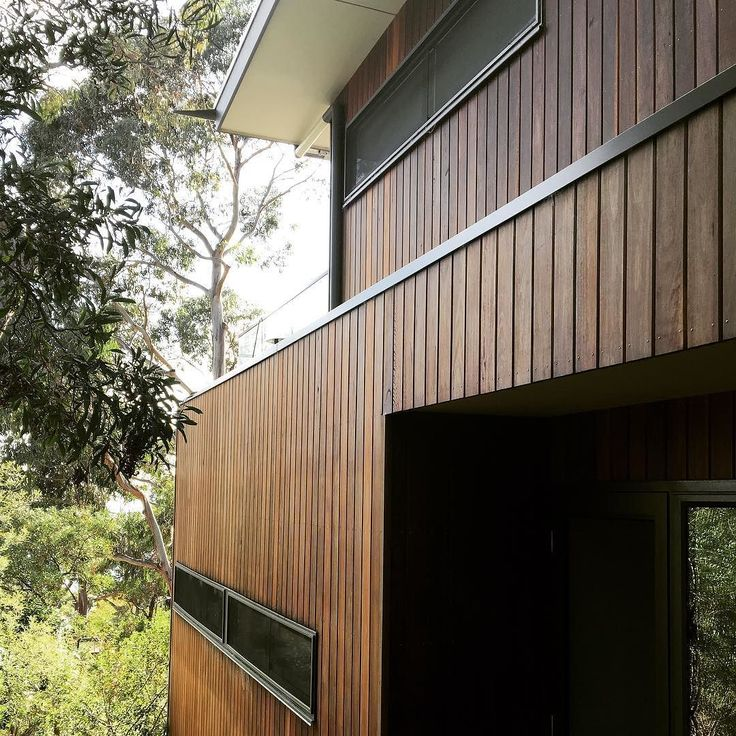 Lorne Residence - Spotted Gum cladding blending with the massive eucalypts on the site. #beachhouse #timbercladding #australianbush #lorne #coastalliving @barwontimber by mgdesignandbuilding http://ift.tt/1IIGiLS