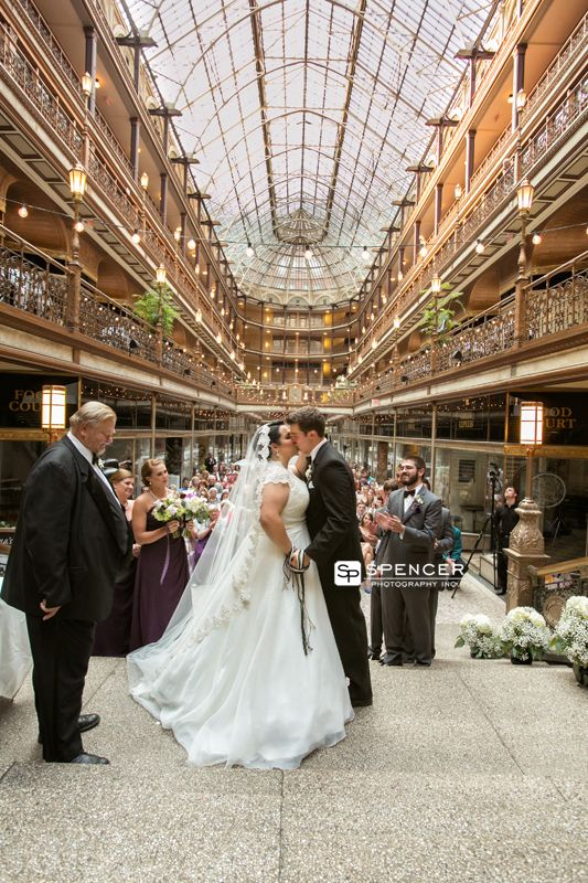 first kiss at the wedding at the cleveland arcade