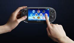The PlayStation Vita handheld in use with the hands of a user demonstrating the new LiveArea touch driven menu system