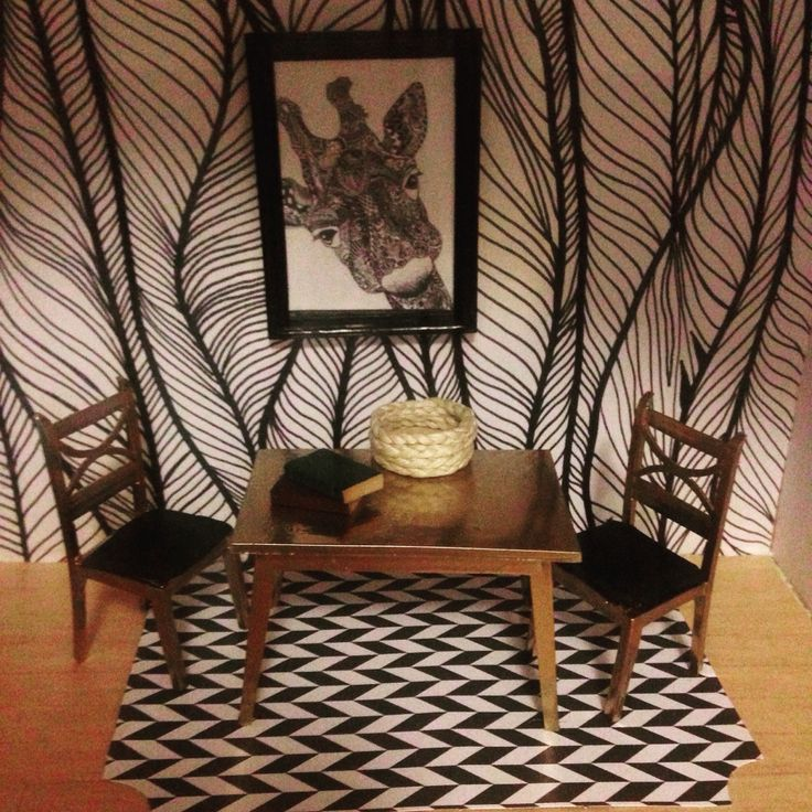 Lola's monochrome sonny angel house. Hand drawn wall paper, the table and chairs are old sylvanian family furniture (was a pea green) then spray painted gold and I re upholstered the seats. The rug is a scrapbook pop out from Kmart. The wall hanging is a picture from google images.