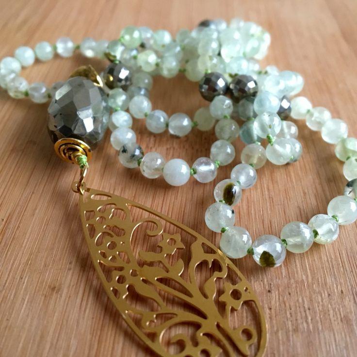Japamala prehenite gemstone and pirita.