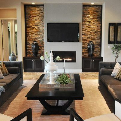 Love the dual lighted niches; should redo this in my living room to add some pop!
