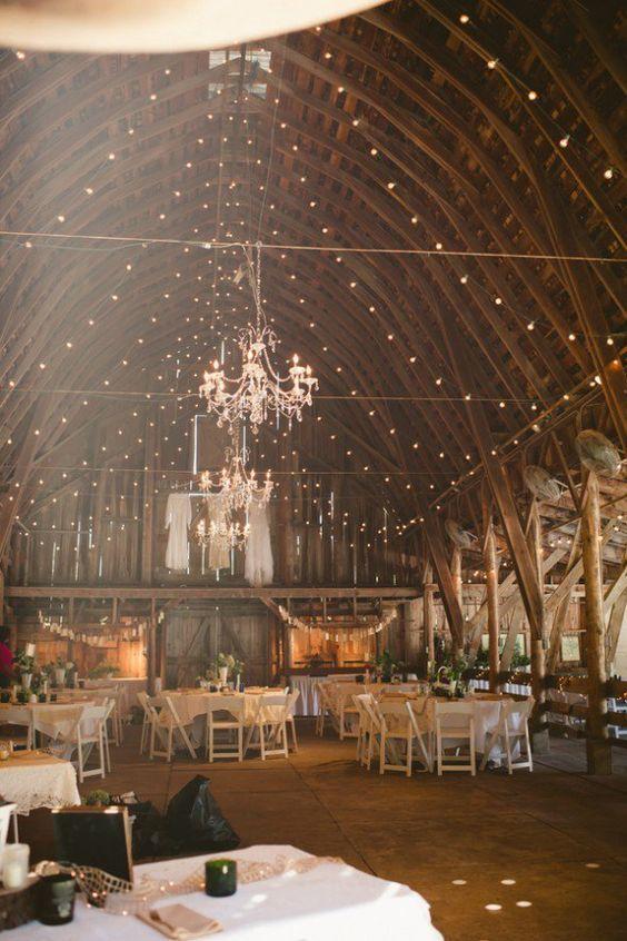 Rustic Chandelier In Barn Wedding / http://www.deerpearlflowers.com/romantic-wedding-lightning-ideas/2/