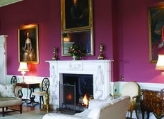 Obsessed with strong paint colours...This raspberry is such a great foil for the art & fireplace