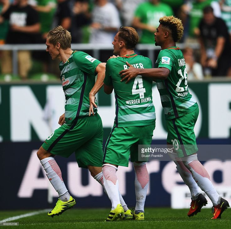 Aron Johannsson of Bremen celebrates scoring his goal with Robert Bauer and Serge Gnabry during the Bundesliga match between Werder Bremen and FC Augsburg at Weserstadion on September 11, 2016 in Bremen, Germany.