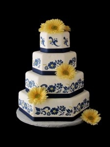 Navy and Yellow Wedding Cake <3 with yellow roses and bluebonnets instead