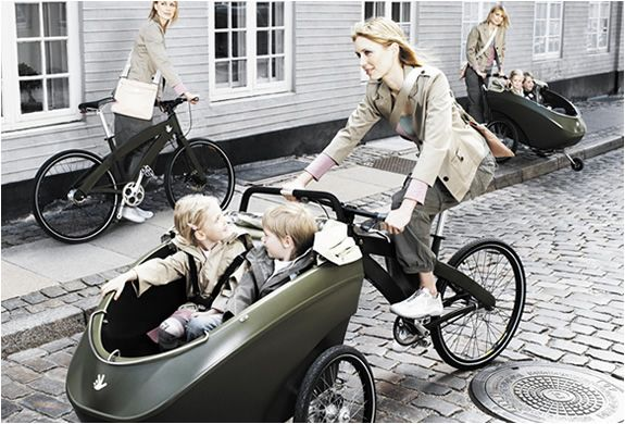 TRIOBIKE   THREE IN ONE BIKE    Triobike from Denmark, is ideal for those wanting to take their children to school safely and quickly, with two seats in front. It also functions as a simple bike, and can be used to transport objects. The trioBike carries up to 80 kg load, or the equivalent of two children under 9 years. It has three main functions: a carrier bike; a bike; and pushchair.