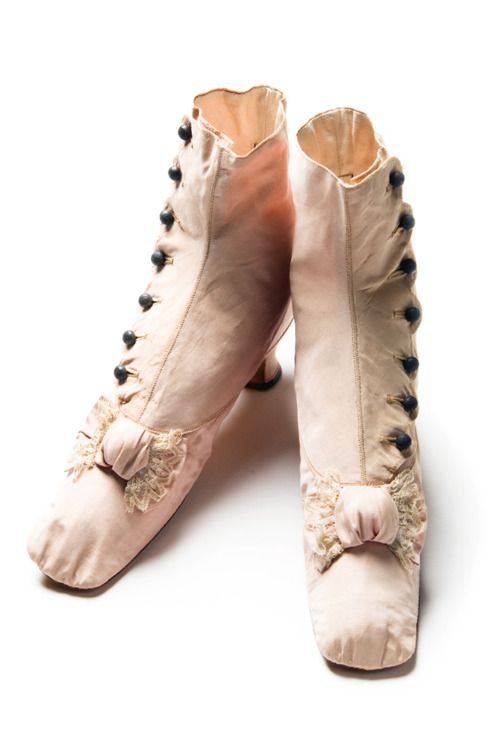 Gift of Gertrude Sanford Legendre in 1979  Pink silk faille shoes, late 19th century. Made by Gartrell / Rue St. Honoré No. 359 / Paris, these stylish boots are trimmed with lace and have embossed pewter buttons.