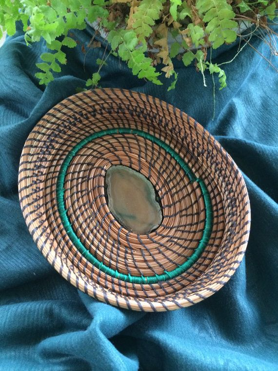 Using southern long leaf pine needles and artificial sinew (waxed thread), each basket is woven and coiled into a unique, one-of-a kind. Pine needle baskets are both lovely and practical, for either display or on a table to hold your car keys or candy. They make great gifts, especially for the person who seems to have everything. Baskets are about 6 - 7 in diameter and 1 - 1 1/2 high. Each piece is an original, ready to be added to your collection from Pine Designs