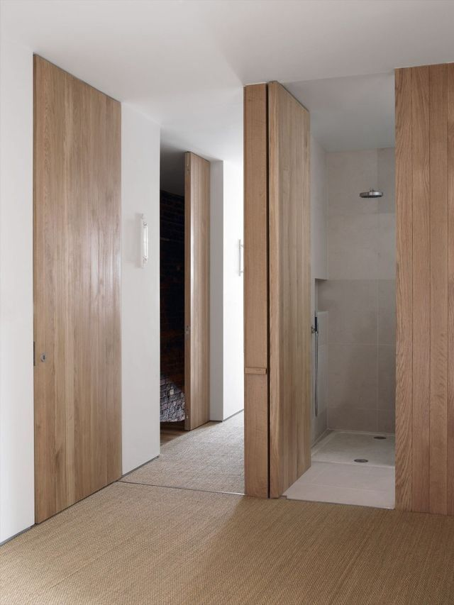 Floor to ceiling wood doors