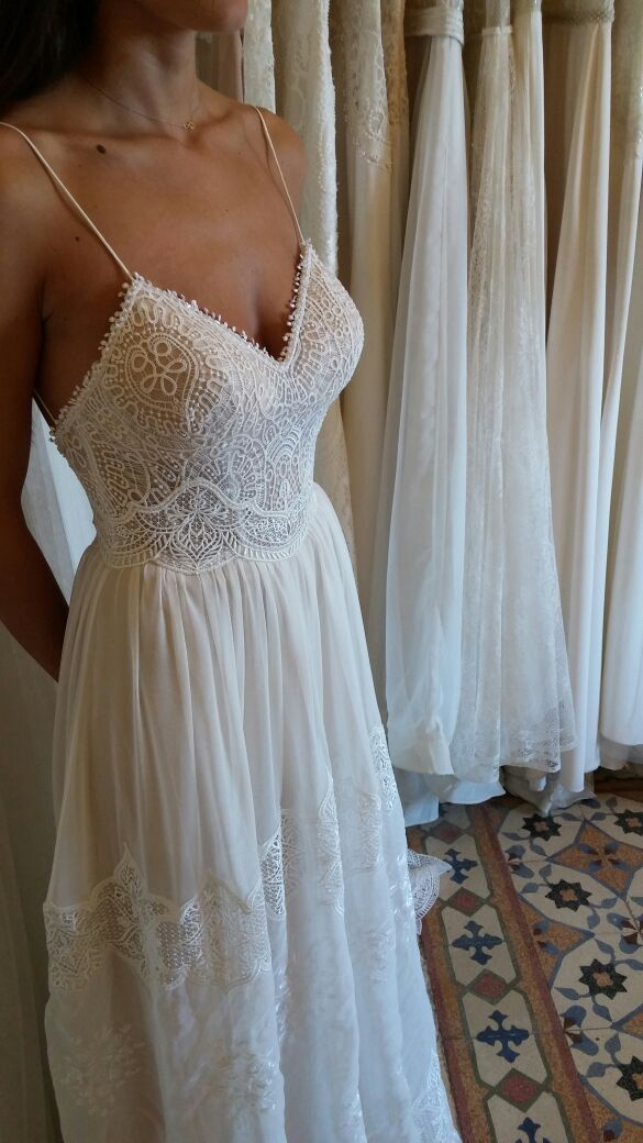 Vintage lace wedding dress | deep neckline | open back | thin straps | flowing skirt | Eva by FLORA