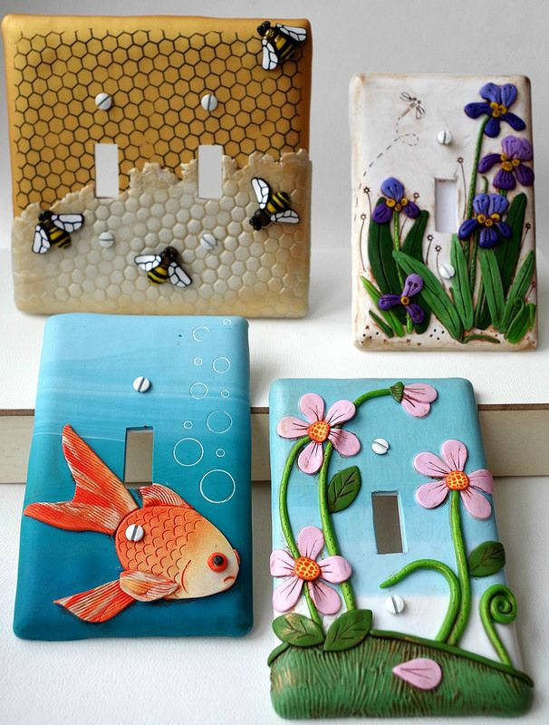 """""""Let there Bee Light,"""" Irises, Koi, and Pink flowers light switch plates by Melissa Terlizzi, polymer clay."""