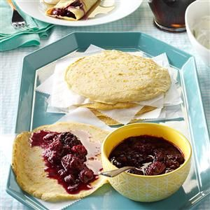 Dutch Pancakes with Berry Coulis Recipe- Recipes %0AMy husband makes his mom's crepe-like Dutch pancakes with our kids on Saturdays. I came up with the berry sauce, and the dish is now our brunch standard. —Shannon Koene, Blacksburg, Virginia