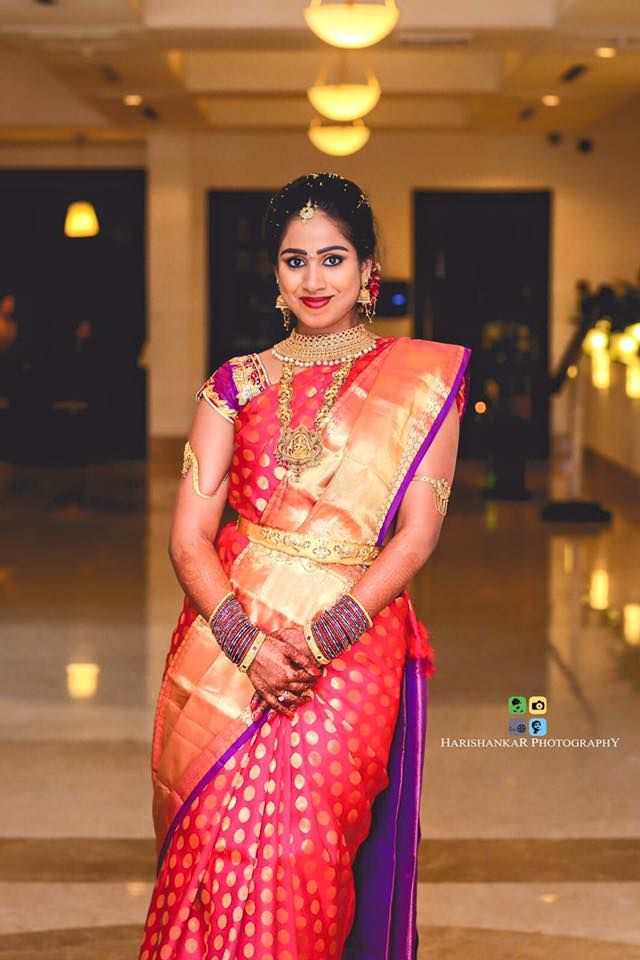 South Indian bride. Temple Indian bridal jewelry. Jhumkis.Pink red silk kanchipuram sari with cap sleeve blouse.Braid with fresh jasmine flowers. Tamil bride. Telugu bride. Kannada bride. Hindu bride. Malayalee bride.Kerala bride.South Indian wedding.