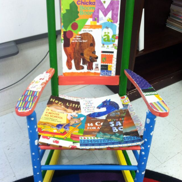 Collected a lot of hard back book covers  took my old wooden rocking chair,Painted it, then used Modge Podge to decoupage school themed scrapbook paper and the book covers. Adorable teacher chair!