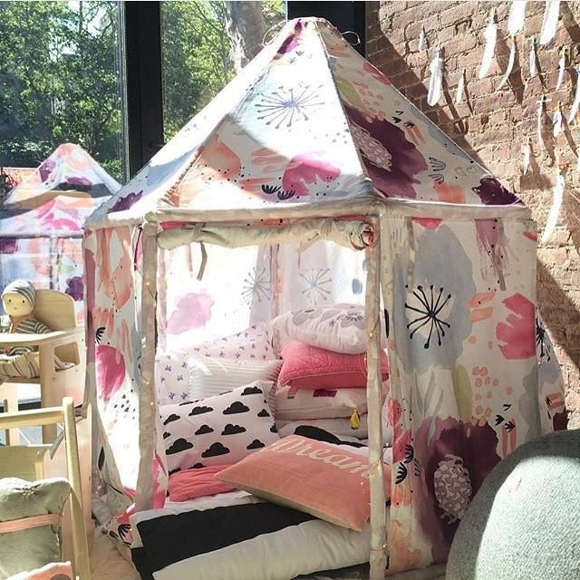 A dreamy pavilion playhome filled with lots of pillows and sleeping bags #nodholiday