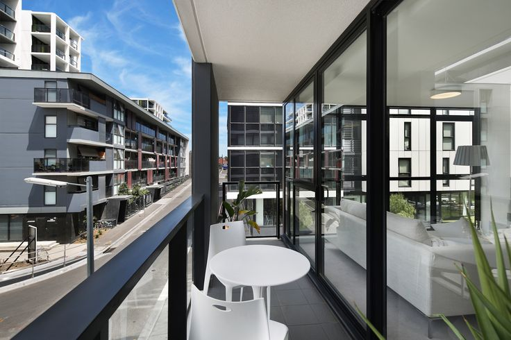 Precinct E102  This corner apartment is finished in a light colour scheme and offers abundant natural light through floor to ceiling windows. The full sized kitchen features plenty of storage, Miele appliances and a beautiful stone-top bench.   Located in the one of the most accessible suburbs in Melbourne, it is just minutes away from the CBD and everything is within reach: shopping, dining, sporting venues, and world-class educational institutions.
