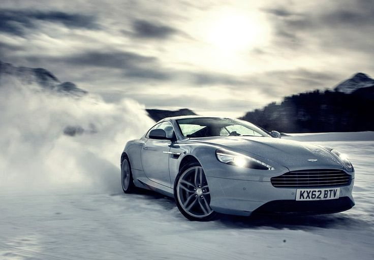 Aston Martin drifting on snow