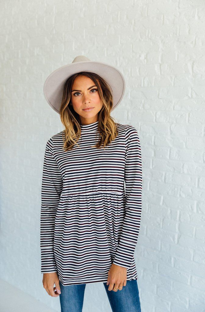 DETAILS: Multi-color stripe long sleeve relaxed fit tunic with mock neck and hi-lo hem. Fits true to size 100% COTTON...