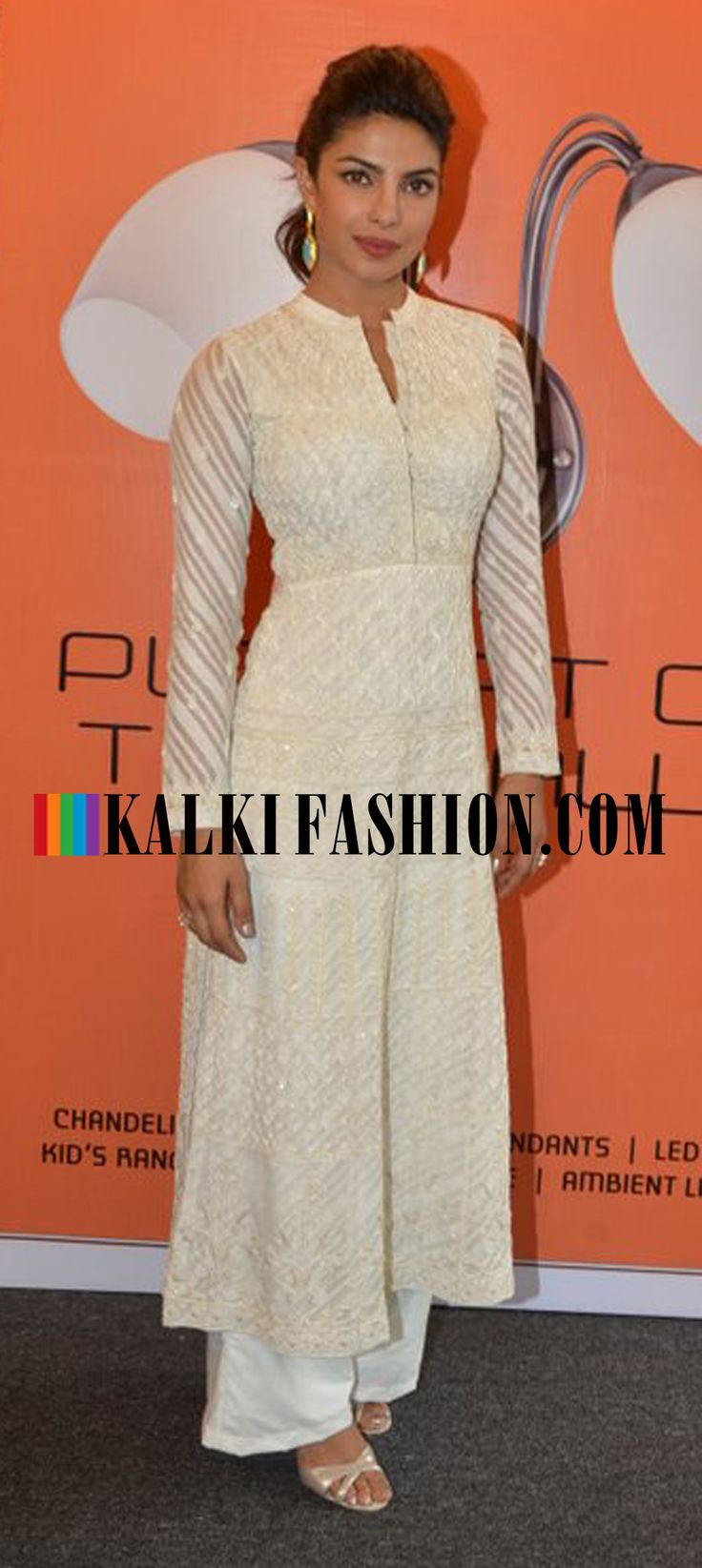 Priyanka Chopra looks stunningly beautiful in the embroidered long kurta by Anita Dongre at an event organized by Usha International http://www.kalkifashion.com/
