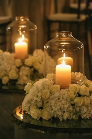 Candles With Hurricanes and White Floral Wreaths | photography by http://www.vuephotographyonline.com/