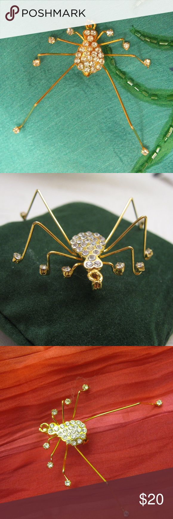 """Rhinestone Gold Dimensional Daddy Long Legs Pin Let this cheery little long legged spider be your new friend.  Shaped like a Daddy Long Legs, this arachnid is constructed of gold tone metal and Aurora Borealis rhinestones.  Rhinestones are set into the body, head, and foot portion of all eight legs.  Secure roll over catch. 2 1/4"""" x 2 1/4"""" x 1"""" high.  4.4g  Fabulous on a jacket, purse, hat, costume or to add to your collection.  (817MP-186) Vintage Jewelry Brooches"""
