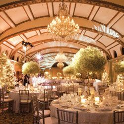 Masses of baby's breath on gleaming silver candelabras make truly impressive, budget-friendly centerpieces.