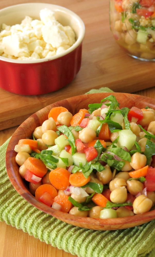 Vegetable loaded Chick Pea Salad with a red wine vinegar dressing. It's the perfect make ahead recipe 'cuz it tastes even better the next day! Pack it mason jars for lunches!