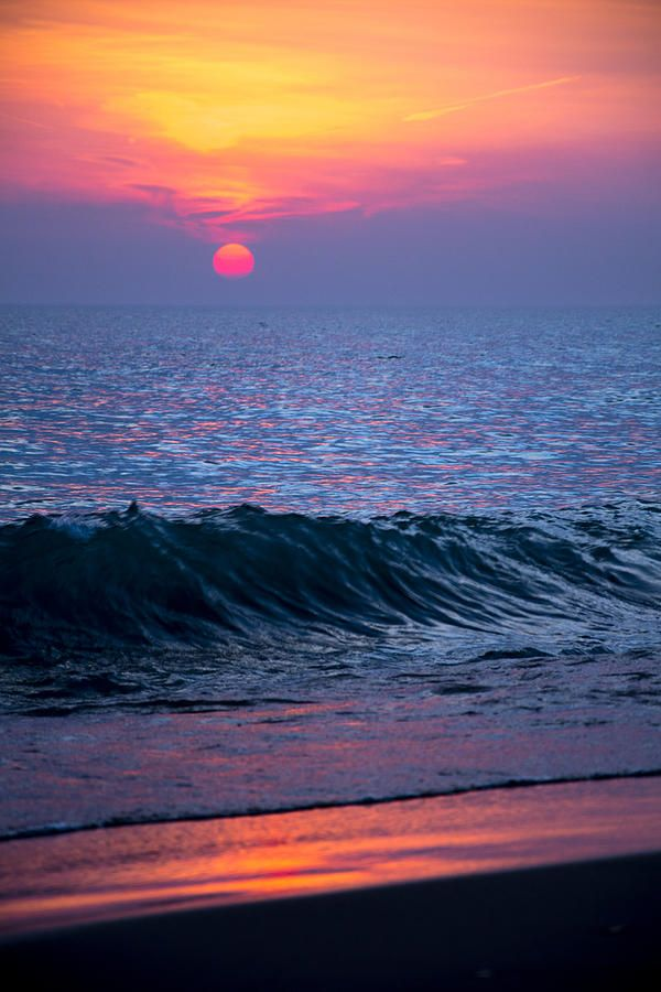 Sunrise on the shores of Lake Michigan  (by Michael Bennett)