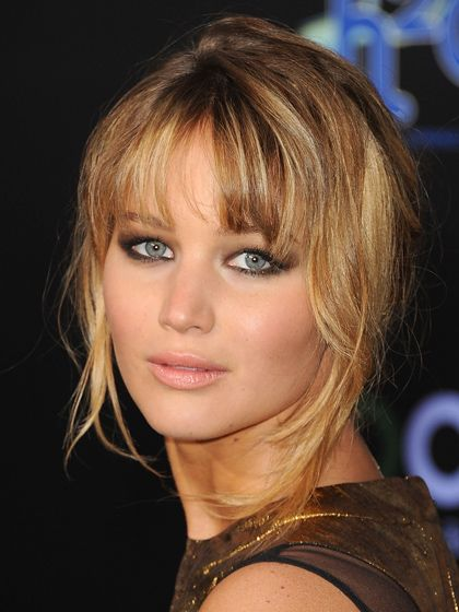 Jennifer Lawrence owns the blunt bangs look by cutting hers at her brows and blending them with wispy layers in the front. More easy hairstyle tips at: http://www.esalon.com/blog/easy-hair-fixes/
