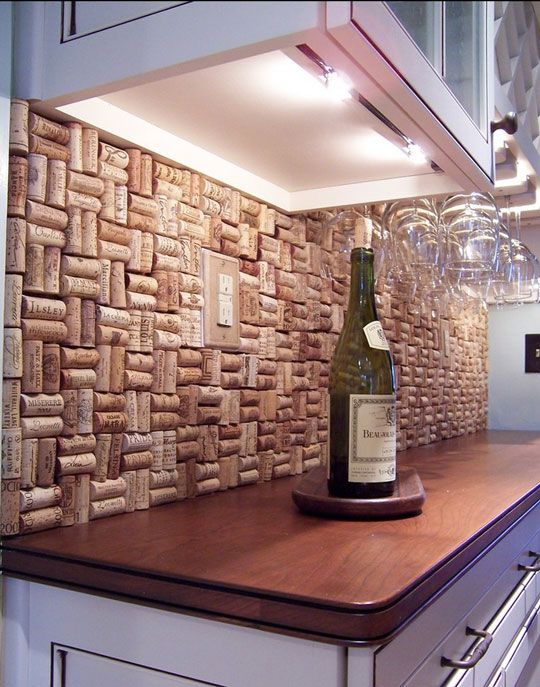 Wine cork backsplash. Great idea for a wet bar or message center, it doubles as a bulletin board!