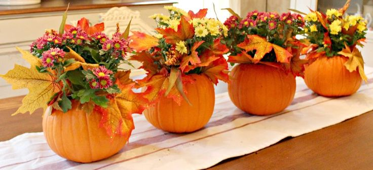 """5 Minute Pumpkin Centerpieces Use 5-6"""" pumpkin & cut 4"""" opening on the top. Don't bother taking out the seeds. Fill with a small amount of 'soil'. Take fall 'mums' out of planting pot & place them in the soil. Now add (Dollar Store) fall 'leaves' as fillers. Water your new centre piece. If water seeps out just let it drain a bit."""