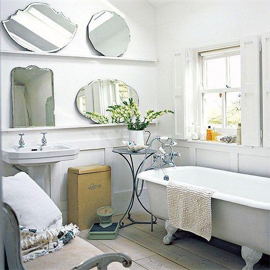 White farmhouse bathroom - like the floors, tub, hamper, bench,walls, and one mirror