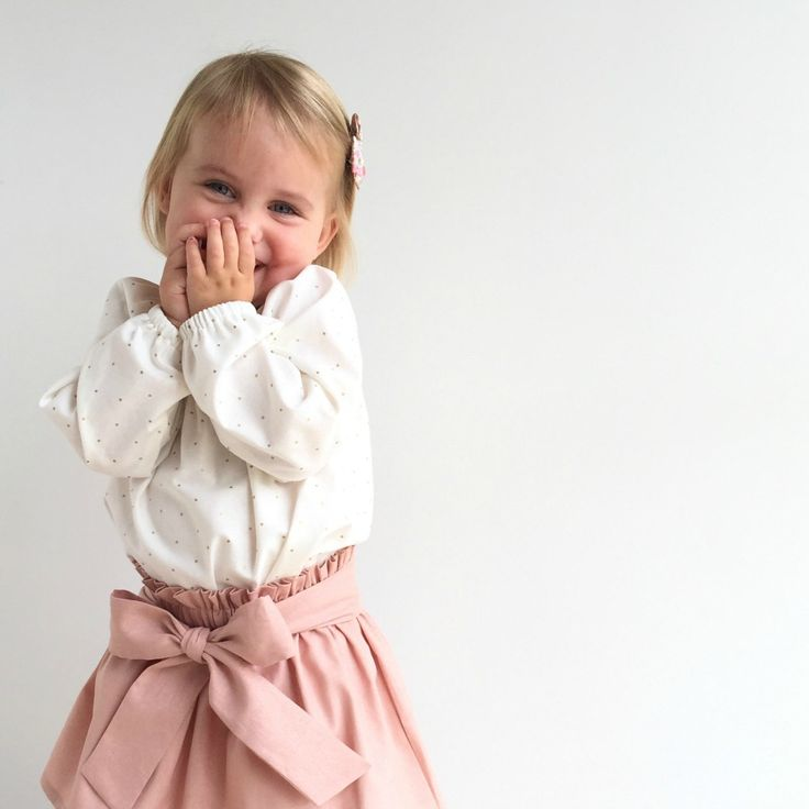 We've designed this sweet long sleeved blouse in classic cream with metallic gold dots for comfortable free play fashion you can wear with shorties, skirts or over leggings during the cooler summer...