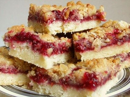 Makes a big pan--like everything else I've pinned it's super easy and they're super yummy. Who doesn't love raspberry bars? Only crazy people. The real secret to these--they call for raspberry jam and real raspberries. It makes a big difference.