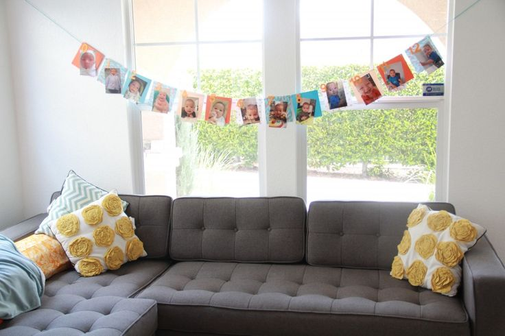 picture banner - one pic for each month w/ accompanying number. YES first birthday ideas!!! (@Catherine Bertrand)