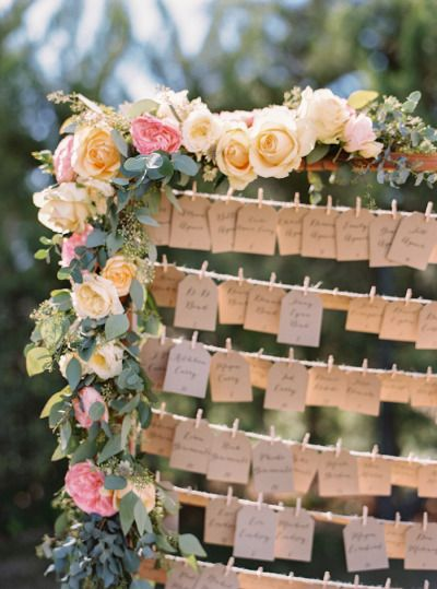 Rose garland and escort card tags: http://www.stylemepretty.com/2015/02/19/southern-inspired-california-summer-wedding/ | Photography: Jessica Burke - http://www.jessicaburke.com/