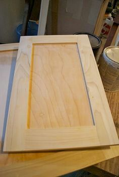 Resurfacing cabinet doors with thin strips of plywood