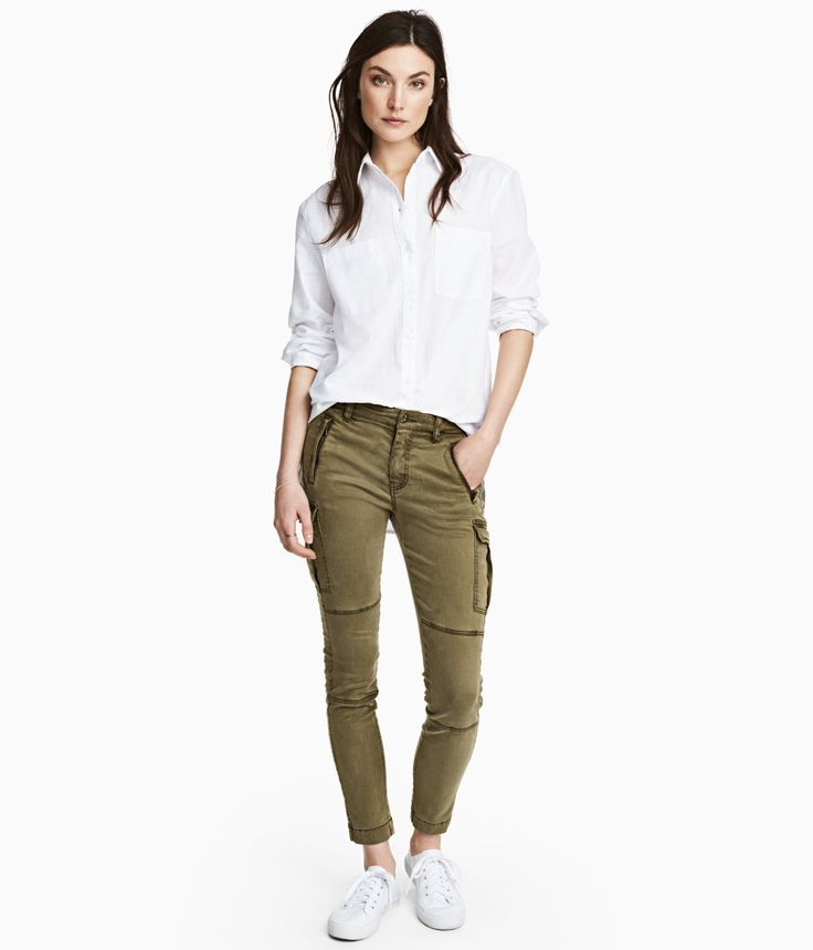 Check this out! CONSCIOUS. Slim-fit, low-rise cargo pants in stretch twill made from a Tencel® lyocell blend. Diagonal front pockets with concealed zip, leg and back pockets with flap and snap fastener, and zip at hems. - Visit hm.com to see more.