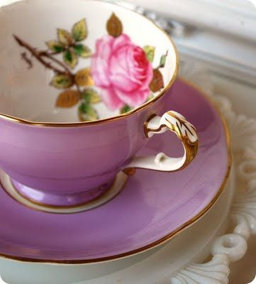 Purple tea cup decorated with a beautiful pink rose on the inside. This is exquisite! And I want it!