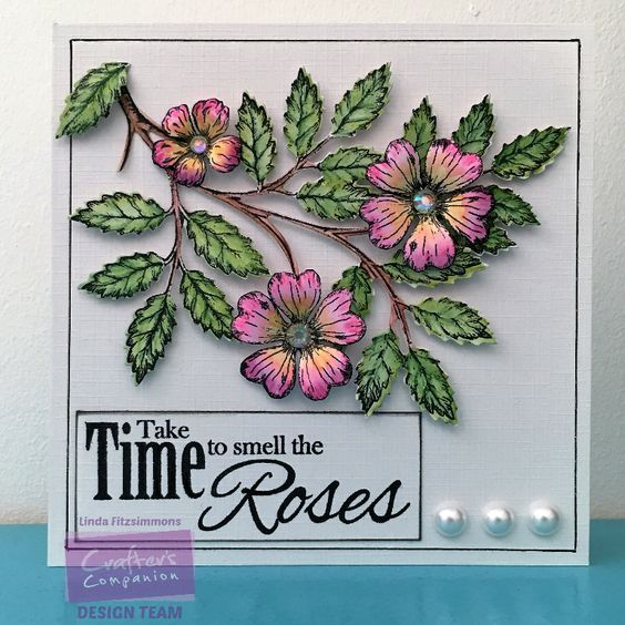Side fold card using Sheena's Wild Rose Briar stamps and dies coloured with Spectrum Noir AquaBlend pencils. Designed by Linda Fitzsimmons #crafterscompanion #spectrumnoir
