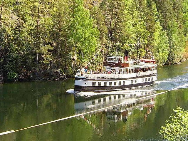 "SUNDAY FEATURE: tomorrow AM, until 12 Noon, we will broadcast ""Telemark Canal; minute by minute"" on our Facebook page - courtesy of NRK TV. You can follow a beautiful trip through Telemark on a gorgeous old steamer, so be sure to tune in!"