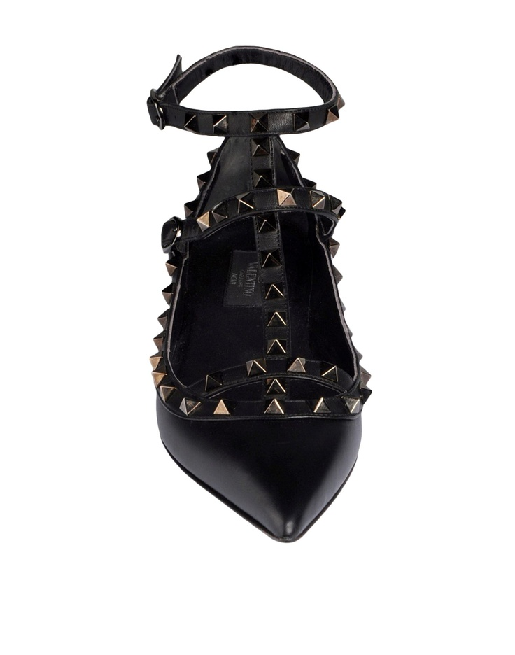 VALENTINO Rockstud NOIR ballerina in calfskin leather and napa. Ruthenium finish stud details. Two adjustable straps. Heel 5 mm/0.25''. Made in Italy.