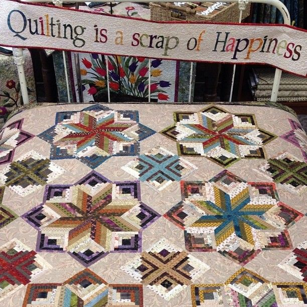 Laundry Basket Quilts -- The smaller 'points' of the stars in this quilt used log cabin blocks. Very interesting construction when looked at as a whole but it is made with some simpler components.                                                                                                                                                                                 Mais