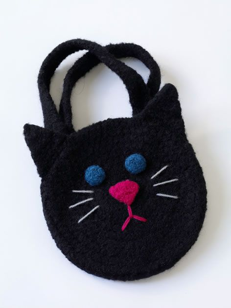 This cute little crochet cat bag from Lion Brand Yarn would make a sweet trick-or-treat bag that could then be used as a purse after Halloween has passed. My daughter is going as a black cat for Ha...